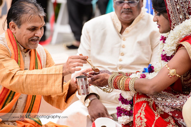 indian bride during kanyadanam panigrahanam at Brazilian Room - Tilden Regional Park, Berkeley