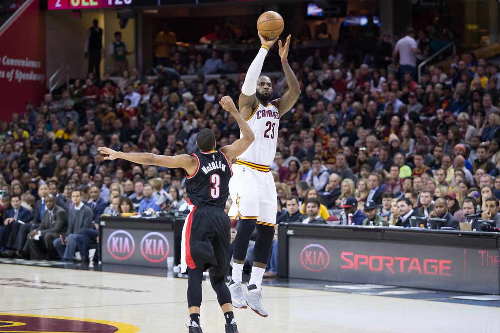 . Michael Johnson - The News-Herald Lebron James of the Cleveland Cavaliers (23) shoots a three over CJ McCollum (3) during a home game against the Portland Trailblazers on November 23, 2016 at the Quicken Loans Arena. The Cavs defeated the Trailblazers 137-125