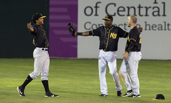 The New Britain Bees defeated the Sugarland Skeeters 6-1 on June 21, 2019. Left fielder Jared James (11), center fielder Alejandro De Aza (8) and right fielder Bijan Rademacher (28) congratulate each other on the win. Wesley Bunnell | Staff
