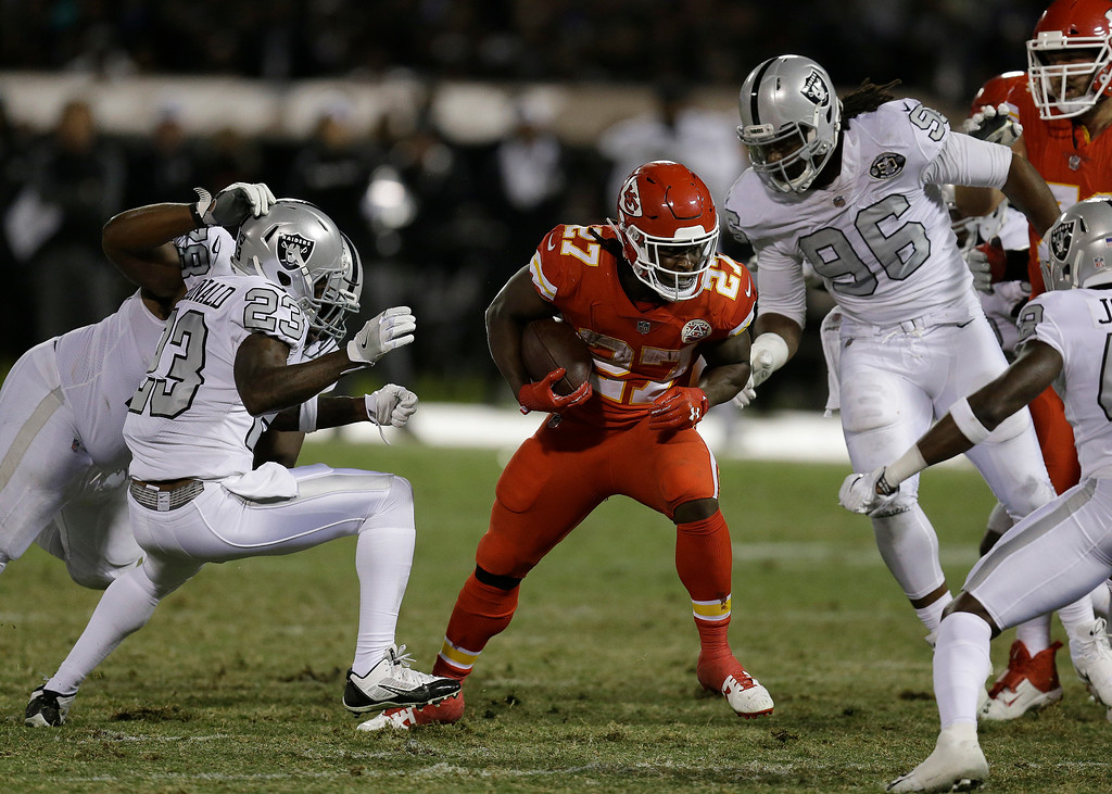 . Kansas City Chiefs running back Kareem Hunt (27) runs against the Oakland Raiders during the second half of an NFL football game in Oakland, Calif., Thursday, Oct. 19, 2017. (AP Photo/Ben Margot)