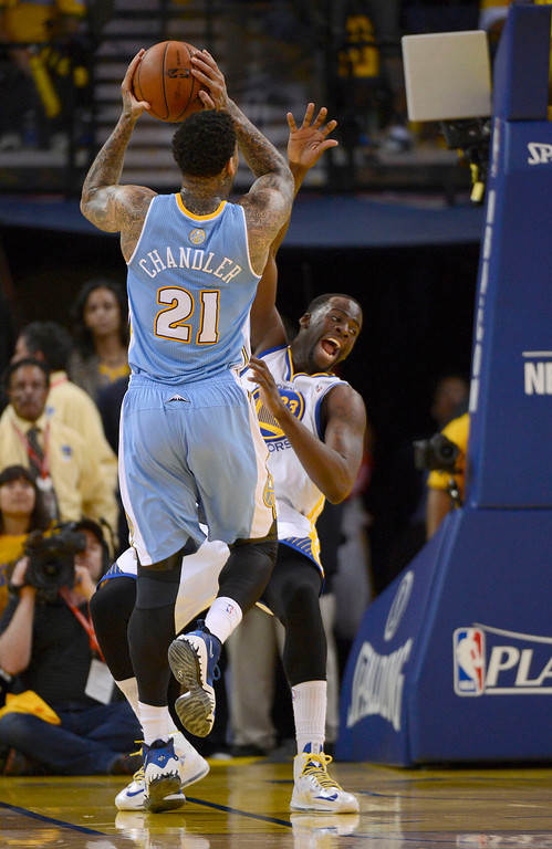 . Wilson Chandler (21) of the Denver Nuggets runs in to Draymond Green (23) of the Golden State Warriors and was called for an offensive foul in Game 4 of the first round NBA Playoffs April 28, 2013 at Oracle Arena. (Photo By John Leyba/The Denver Post)