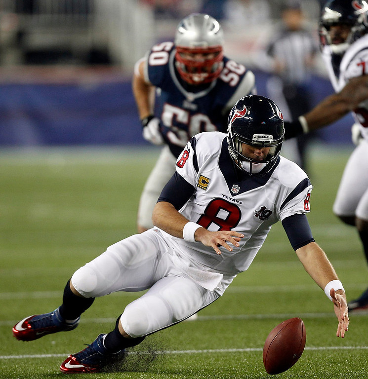 . Houston Texans quarterback Matt Schaub (8) recovers his own fumble as New England Patriots defensive end Rob Ninkovich (50) closes in on him during the second half of an AFC divisional playoff NFL football game in Foxborough, Mass., Sunday, Jan. 13, 2013. (AP Photo/Stephan Savoia)