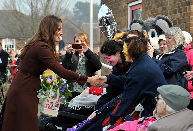 . Catherine, Duchess of Cambridge meets residence of nearby St.Andrews Hospice as she visits Humberside Fire and Rescue Peaks Lane Fire Station on March 5, 2013 in Grimsby, England.  (Photo Bruce Adams  - WPA Pool/Getty Images)