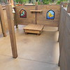maze with timber fencing and ships bell and artworks