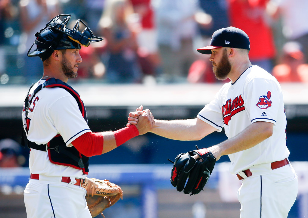 . Cleveland Indians\' Yan Gomes, left, and Cody Allen celebrate a victory over the New York Yankees in a baseball game, Sunday, July 15, 2018, in Cleveland. (AP Photo/Ron Schwane)