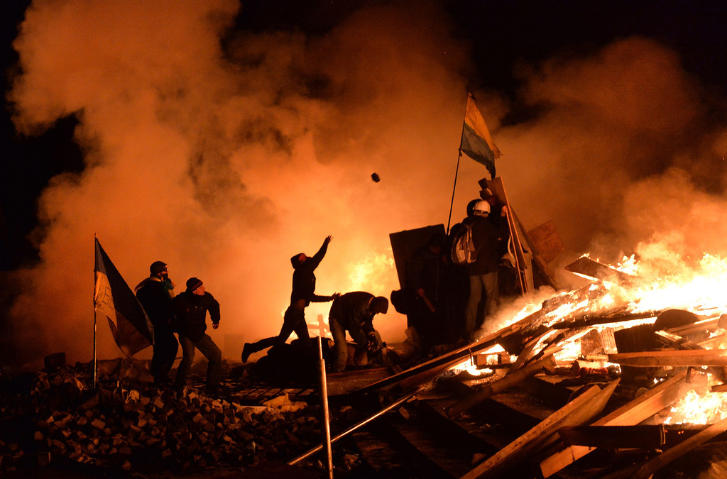 . Anti-government protesters throw cobblestones as they clash with the police on Independence Square in Kiev early on February 19, 2014.   AFP PHOTO/SERGEI  SUPINSKY/AFP/Getty Images