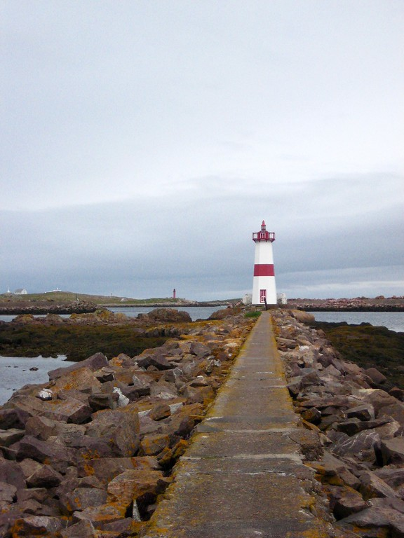 lighthouse at the end of a jetty
