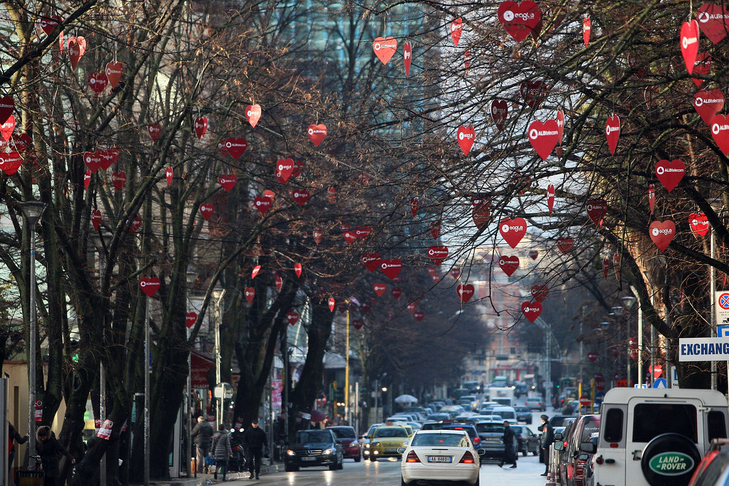 . Trees are decorated with heart shapes in the central district of Tirana on Valentine\'s Day, on February 14, 2014. AFP PHOTO / GENT SHKULLAKU/AFP/Getty Images