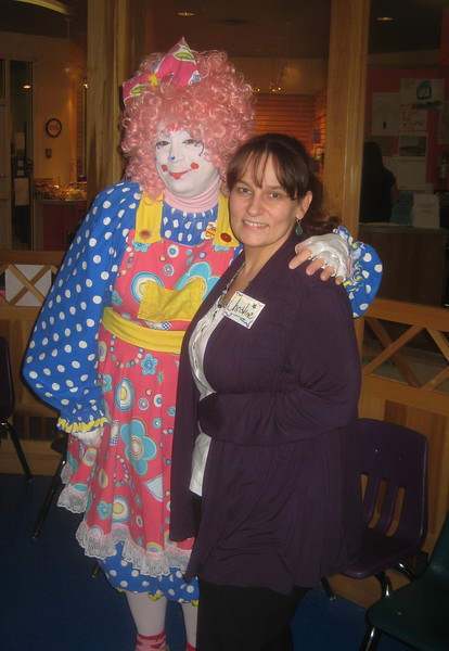 Christine Alger, secretary of the Friends, posing with Shuffles the Clown during the Feb 12th fundraiser at the Children's Museum.  See separate album for this event.