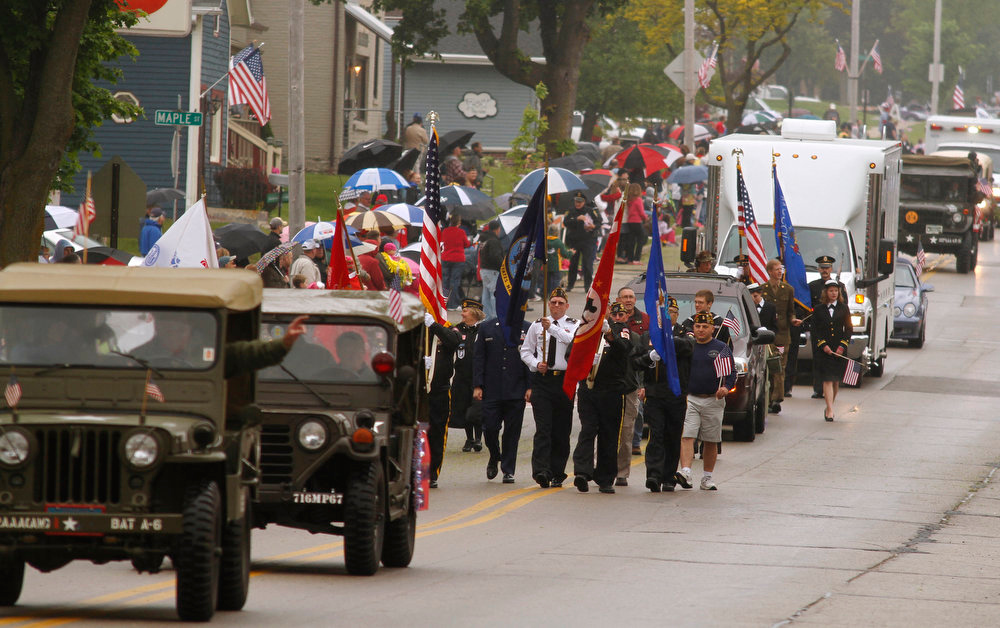 . The Memorial Day parade partipants march through West Bend, Wisc.,  on Monday, May 27, 2013.  (AP Photo/The Daily News, John Ehlke)