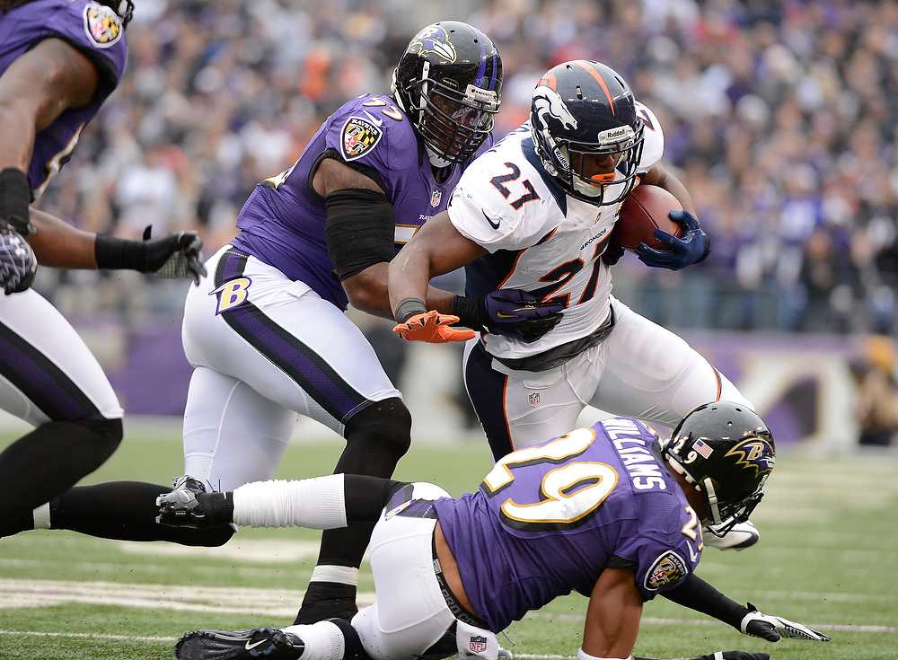 Description of . Denver Broncos running back Knowshon Moreno (27) picks up a few yards as he is brought down by Baltimore Ravens cornerback Cary Williams (29) during the first quarter Sunday, December 16, 2012 at M&T Bank Stadium. John Leyba, The Denver Post