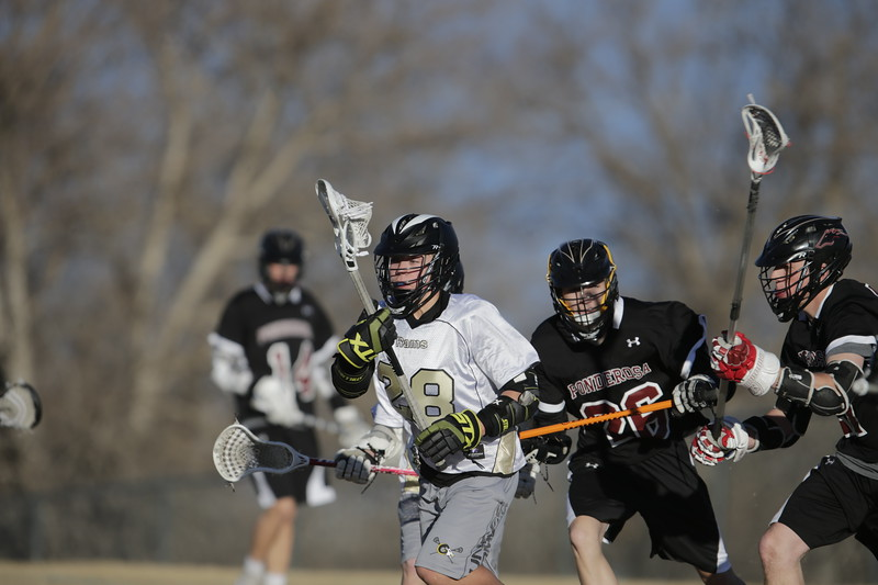 JPM0314-JPM0314-Jonathan first HS lacrosse game March 9th.jpg