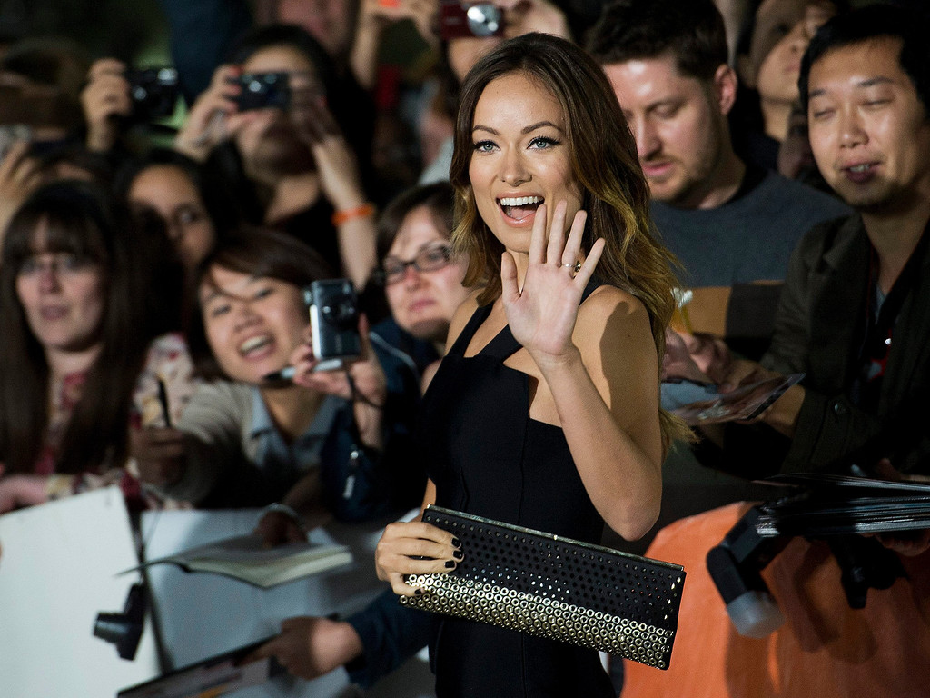""". Actress Olivia Wilde poses for a photograph on the red carpet at the gala for the new movie \""""Rush\"""" during the 2013 Toronto International Film Festival in Toronto on Sunday, Sept. 8, 2013. (AP Photo/The Canadian Press, Nathan Denette)"""