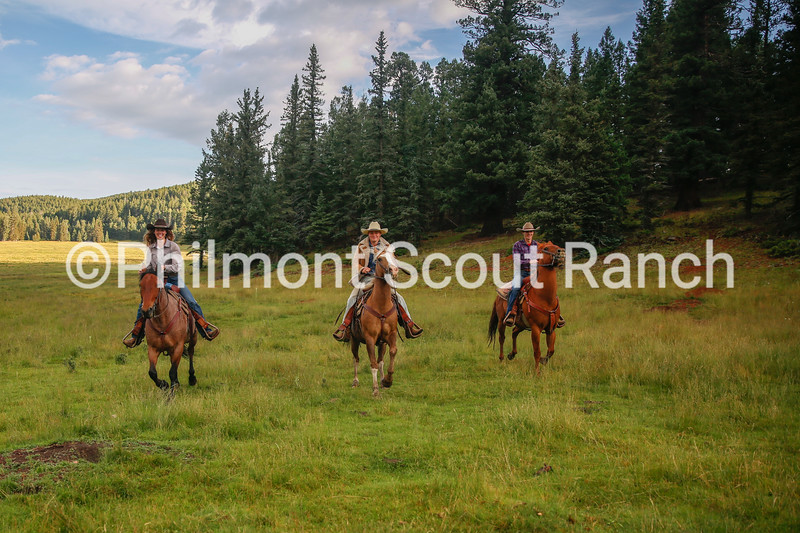 Coeli Clemons, Matthew Book and Ryan Kihl ride their horses for an early morning ride at Beaubien on Monday, August 5, 2019 at Philmont Scout Ranch in Cimarron, New Mexico.
