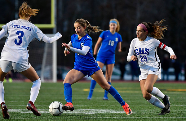 11/23/2019 Mike Orazzi | Staff Southington High School's Emma Panarella (7) and Glastonbury's Jaci Budaj (3) and Alexandra Bedard (29) during the Class LL Girls State Soccer Tournament at Veterans Stadium in New Britain Saturday evening. Glastonbury won 1-0.