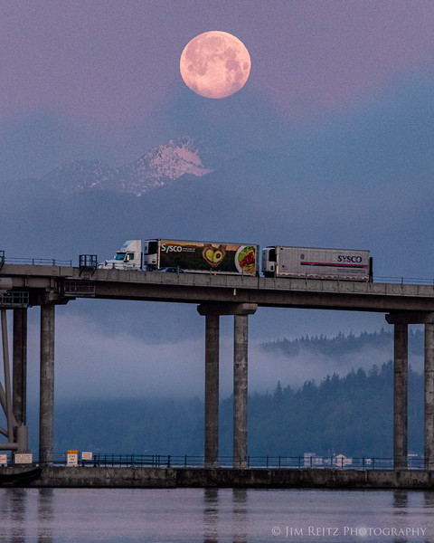 """Lunar Trucking"" - moonset this morning at the Hood Canal Bridge. Olympic Mountains in the background."