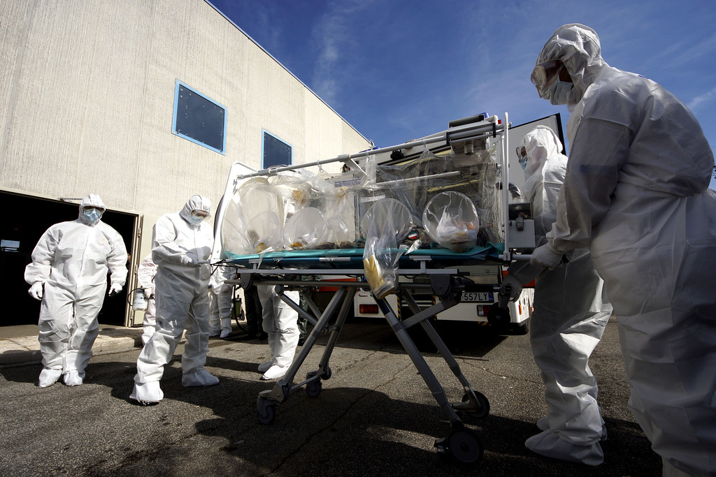 . Participants into a course to learn how to transport and handle contagious patients use an \'Aircraft Transit Isolator\' (ATI) to carry a colleague during a simulation at the military airport of Pratica di Mare, 30 kilometers south of Rome, Wednesday, Sept. 24, 2014. Italy\'s defense ministry staged the simulated medical evacuation of an Ebola patient Wednesday as part of a three-day training course for Italian military, Red Cross and health care workers. Some of them are on the front lines of Italy\'s Mare Nostrum rescue operation for thousands of African migrants who are arriving here every day in smugglers\' boats. Officials and medical experts insist that the risk that Ebola might spread from Africa to Europe is small. They say Italy\'s first case of Ebola will most likely be from an Italian doctor or missionary who contracts it while caring for patients in Liberia, Sierra Leone or Guinea _ the three hardest-hit countries _ and is airlifted home. (AP Photo/Domenico Stinellis)