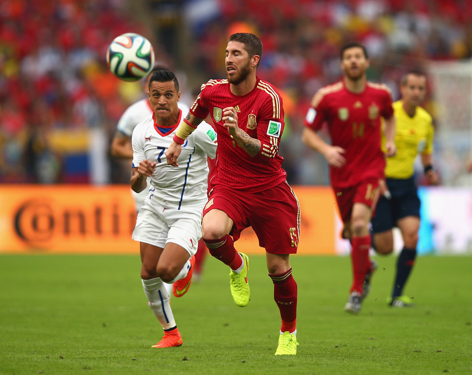 . Sergio Ramos of Spain controls the ball against Alexis Sanchez of Chile during the 2014 FIFA World Cup Brazil Group B match between Spain and Chile at Maracana on June 18, 2014 in Rio de Janeiro, Brazil.  (Photo by Clive Rose/Getty Images)