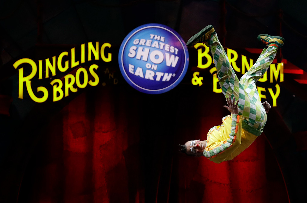 ". A Ringling Bros. and Barnum & Bailey clown does a somersault during a performance Saturday, Jan. 14, 2017, in Orlando, Fla. The Ringling Bros. and Barnum & Bailey Circus will end the ""The Greatest Show on Earth\"" in May, following a 146-year run of performances. Kenneth Feld, the chairman and CEO of Feld Entertainment, which owns the circus, told The Associated Press, declining attendance combined with high operating costs are among the reasons for closing. (AP Photo/Chris O\'Meara)"