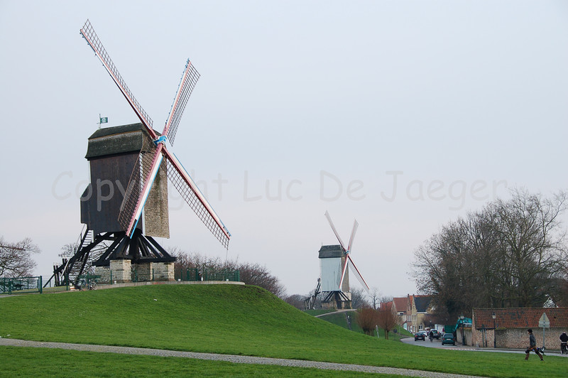 Two of the four mills (molens) along the Kruisvest in Bruges (Brugge), Belgium. To the left is the Sint-Janshuismolen (built in 1770), the 2nd counting from the Kruispoort. In the middle of the photo is the first mill, counting from the Kruispoort, named the Bonne-Chièremolen (dating from 1844).
