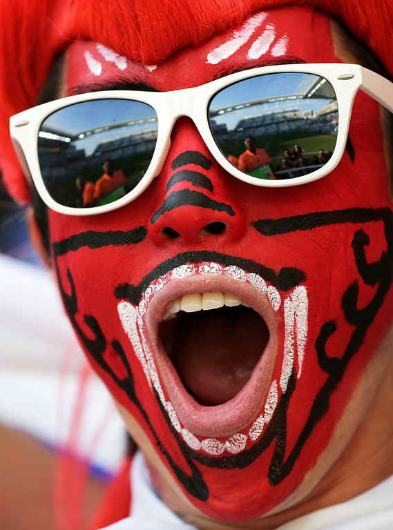 . A South Korea fan cheers during the group H World Cup soccer match between South Korea and Belgium at the Itaquerao Stadium in Sao Paulo, Brazil, Thursday, June 26, 2014. (AP Photo/Felipe Dana)