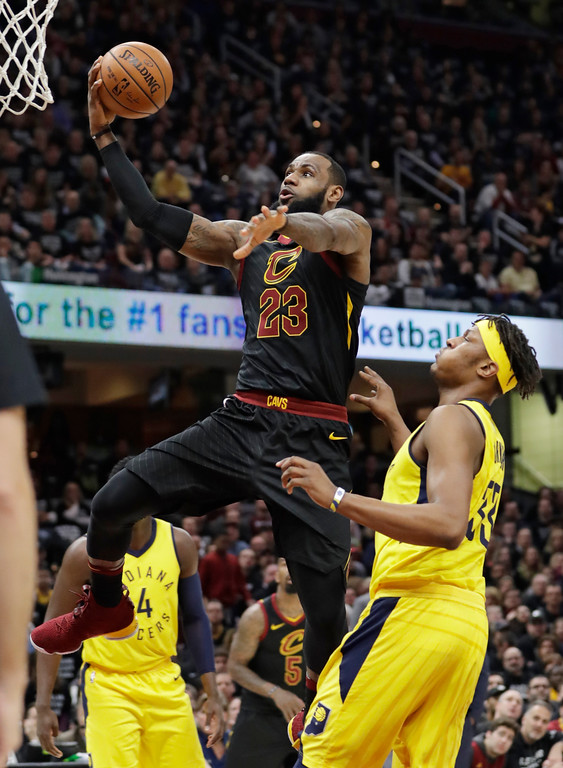 . Cleveland Cavaliers\' LeBron James (23) drives to the basket against Indiana Pacers\' Myles Turner (33) in the first half of Game 7 of an NBA basketball first-round playoff series, Sunday, April 29, 2018, in Cleveland. (AP Photo/Tony Dejak)