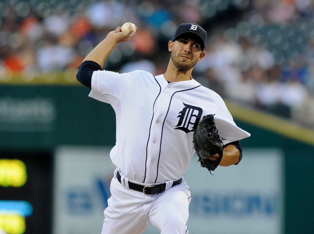 . Detroit Tigers pitcher Rick Porcello throws against the San Francisco Giants in the first inning of a baseball game Friday, Sept. 5, 2014, in Detroit. (AP Photo/Jose Juarez)
