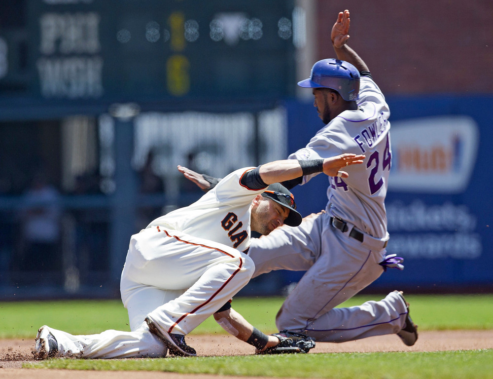 . Dexter Fowler #24 of the Colorado Rockies steals second base ahead of a tag from Marco Scutaro #19 of the San Francisco Giants during the first inning at AT&T Park on May 26, 2013 in San Francisco, California. (Photo by Jason O. Watson/Getty Images)