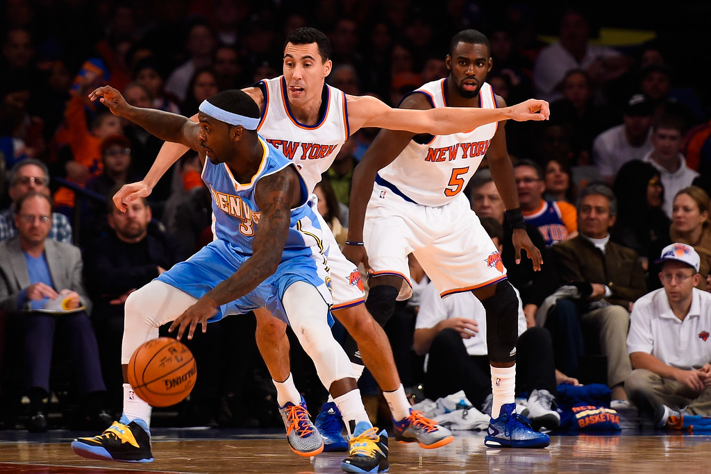 . NEW YORK, NY - NOVEMBER 16: Ty Lawson #3 of the Denver Nuggets dribbles around Pablo Prigioni #9 of the New York Knicks in the second half at Madison Square Garden on November 16, 2014 in New York City. NOTE TO USER: User expressly acknowledges and agrees that, by downloading and/or using this photograph, user is consenting to the terms and conditions of the Getty Images License Agreement.  (Photo by Alex Goodlett/Getty Images)