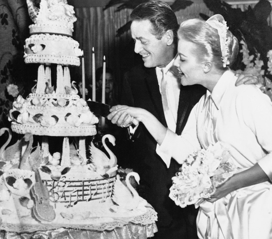 . Patti Page, 29, and dance director Charles O\' Curran, 42, cut the firm piece of their wedding cake after being married, Dec. 29, 1956 in Las Vegas in the home of Wilbur Clark. It was the second marriage for Miss Page and the third for O\' Curran who was most recently married to Betty Hutton. (AP Photo)