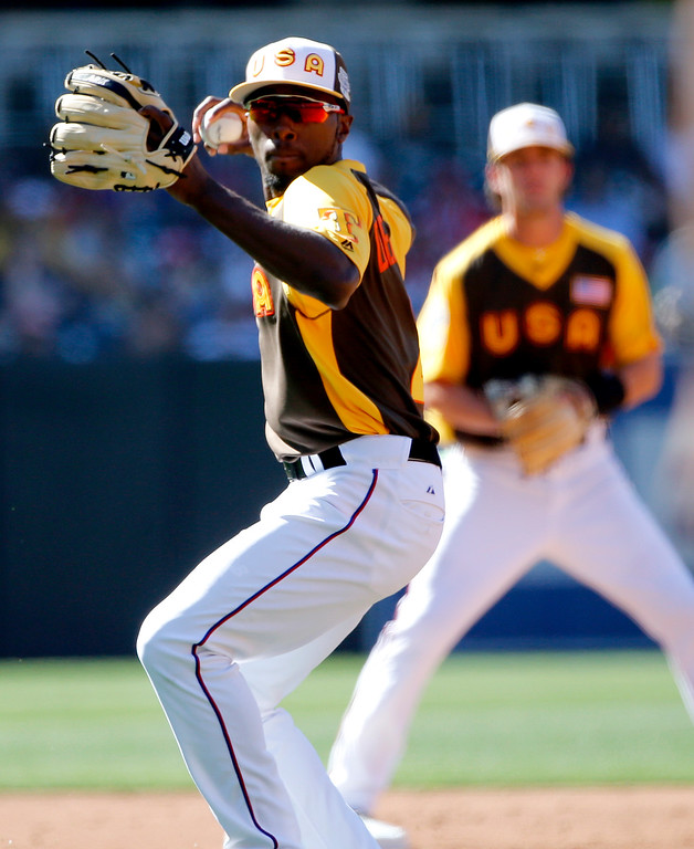 . U.S. Team\'s Travis Demeritte, of the Texas Rangers, throws to first against the World Team during the second inning of the All-Star Futures baseball game, Sunday, July 10, 2016, in San Diego. (AP Photo/Lenny Ignelzi)