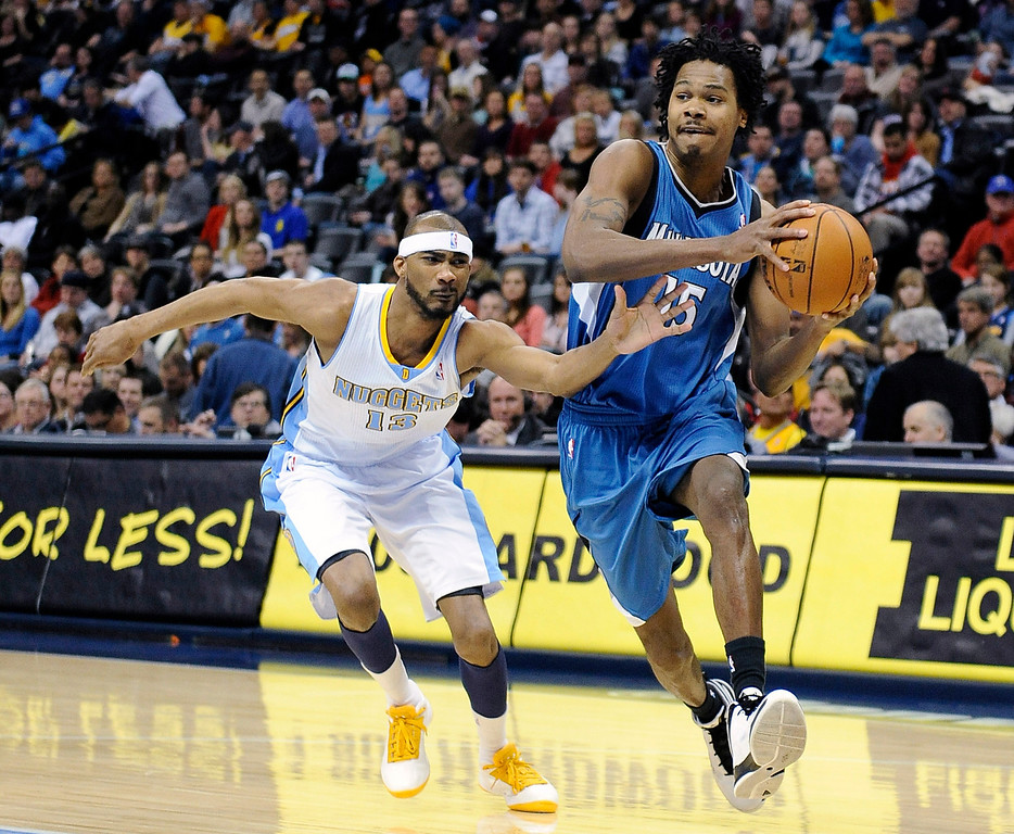 . Denver Nuggets forward Corey Brewer, left, tries to defend Minnesota Timberwolves forward Mickael Gelabale during the first quarter of an NBA basketball game Saturday, March 9, 2013, in Denver. (AP Photo/Chris Schneider)
