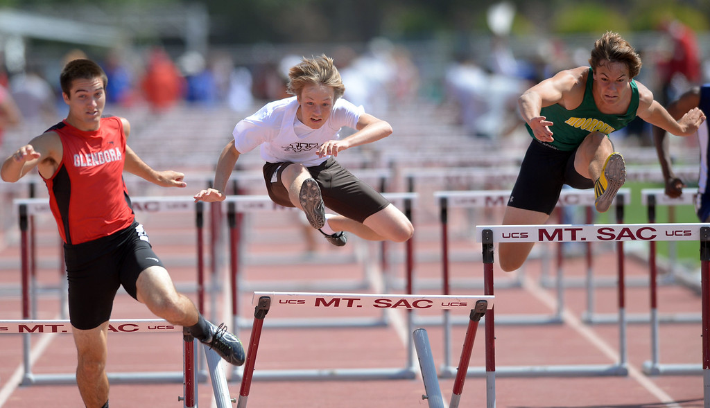 . West\'s Senna Bland competes in the 110 meter Division 2 high hurdles race of the CIF Southern Section Track and Field Championships Saturday at Mt. SAC. He would later win the 300 hurdles race as well. 20130518 Photo by Steve McCrank / Staff Photographer