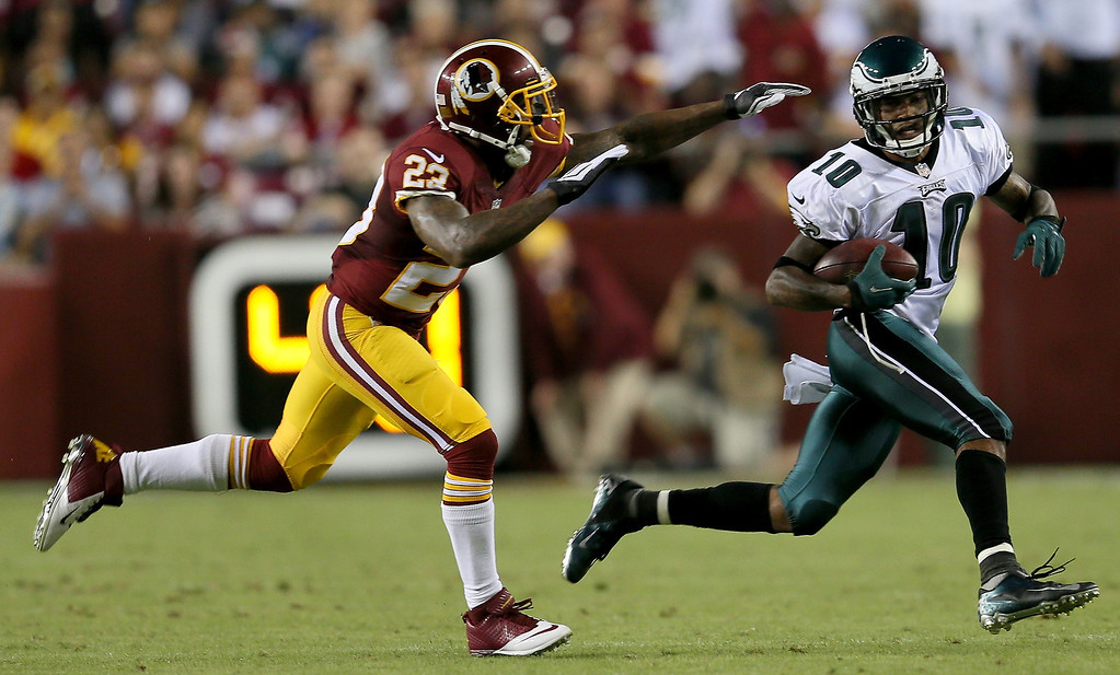 . Wide receiver DeSean Jackson #10 of the Philadelphia Eagles runs after a catch against running back Chris Thompson #25 of the Washington Redskins in the second quarter at FedExField on September 9, 2013 in Landover, Maryland.  (Photo by Rob Carr/Getty Images)