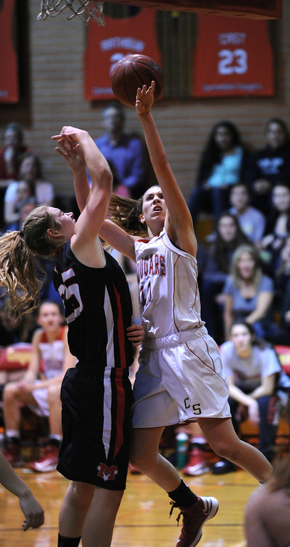. Carondelet High\'s Gabriella Grupalo (11) draws a foul against Monte Vista High\'s Jenn Casper (25) in their high school basketball game played at Carondelet High School in Concord, Calif. on Friday, Feb. 1, 2013. (Dan Honda/Staff)