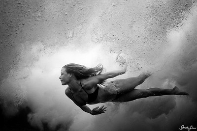 "Water woman, Donica Shouse, swimming through the ""clouds"" of the sea."