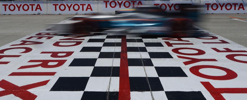 . A race car streaks down Shoreline Drive Sunday. Scott Dixon (9) wins the Toyota Grand Prix of Long Beach Sunday April 19, 2015.  (Will Lester/Staff Photographer)