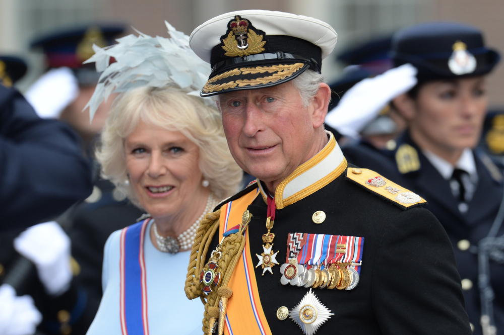 . Britain\'s Prince Charles of Wales and his wife Camilla, Duchess of Cornwall leave the Nieuwe Kerk (New Church) in Amsterdam on April 30, 2013 after attending the investiture of King Willem-Alexander of the Netherlands.  PATRIK STOLLARZ/AFP/Getty Images