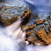 Water flowing between rocks