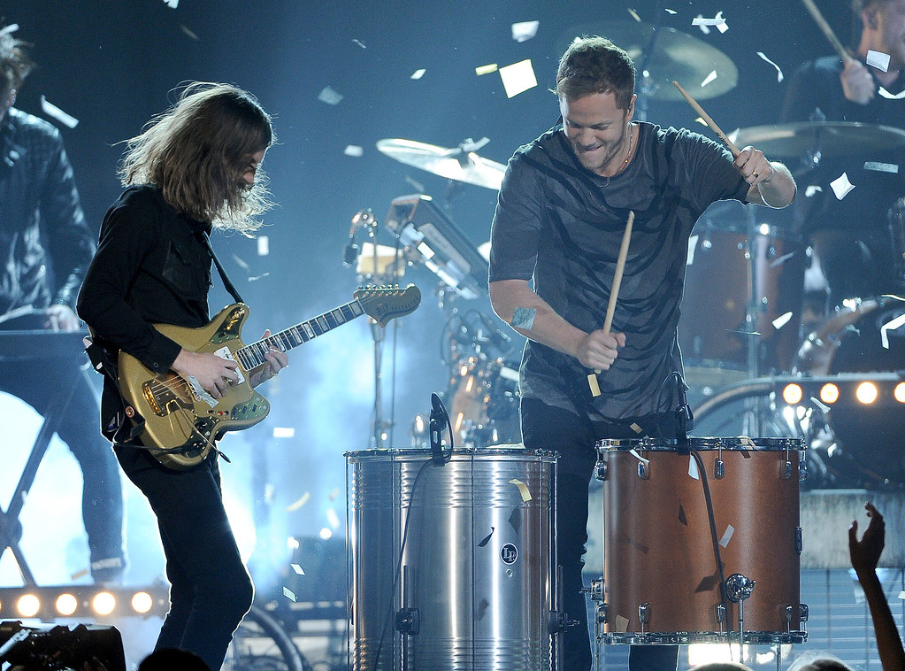 . Wayne Sermon, left, and Dan Reynolds, of the musical group Imagine Dragons, perform at the Billboard Music Awards at the MGM Grand Garden Arena on Sunday, May 18, 2014, in Las Vegas. (Photo by Chris Pizzello/Invision/AP)