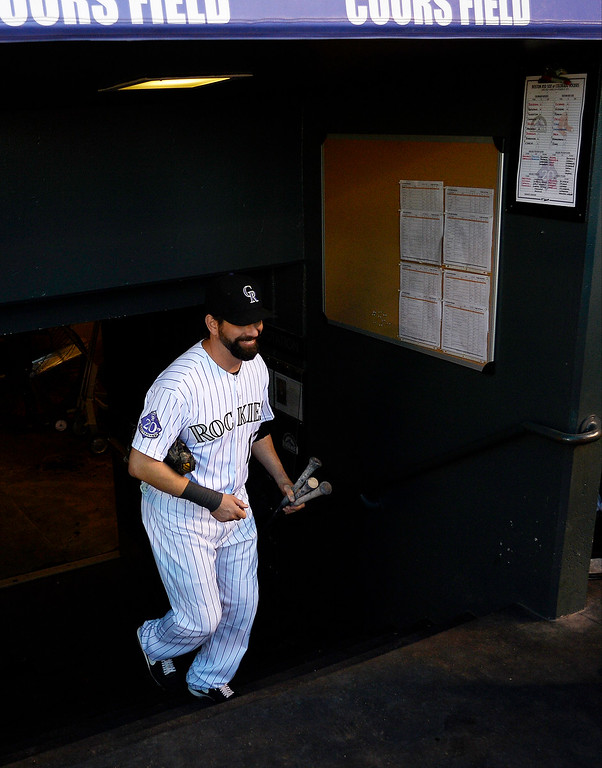 . Todd Helton runs up the stairs into the dugout before the start of action in Denver. The Colorado Rockies hosted the Boston Red Sox and said farewell to longtime first baseman Todd Helton, who recently announced his retirement following this season. (Photo by John Leyba/The Denver Post)