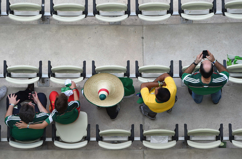 . Fans await the kick-off of a Group A football match between Brazil and Mexico in the Castelao Stadium in Fortaleza during the 2014 FIFA World Cup on June 17, 2014. (FRANCOIS XAVIER MARIT/AFP/Getty Images)