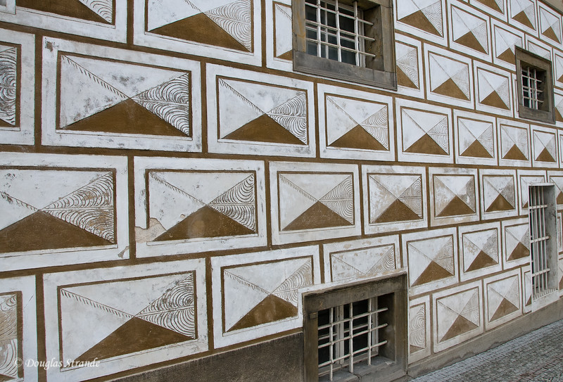 Building faced with Grafito, flat designs which appear to be 3-dimensional blocks