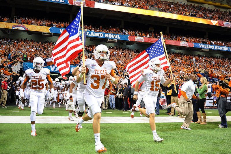 . Luke  Utley #37 and Alex King #15 of the University of Texas Longhorns lead their team onto the field for a game against the Oregon State Beavers during the Valero Alamo Bowl at the Alamodome on December 29, 2012 in San Antonio, Texas.  (Photo by Stacy Revere/Getty Images)
