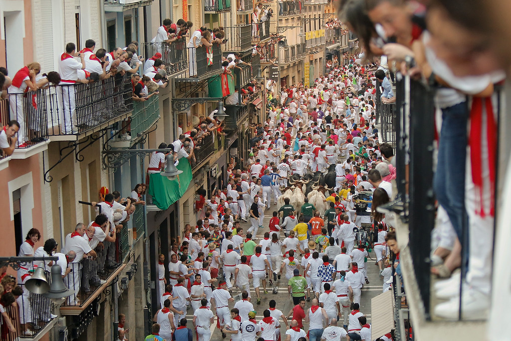 . PAMPLONA, SPAIN - JULY 09:  Revellers run with Valdefresno\'s ranch fighting bulls at Calle Estafeta during the fourth day of the San Fermin Running Of The Bulls festival, on July 9, 2013 in Pamplona, Spain. The annual Fiesta de San Fermin, made famous by the 1926 novel of US writer Ernest Hemmingway \'The Sun Also Rises\', involves the running of the bulls through the historic heart of Pamplona, this year for nine days from July 6-14.  (Photo by Pablo Blazquez Dominguez/Getty Images)