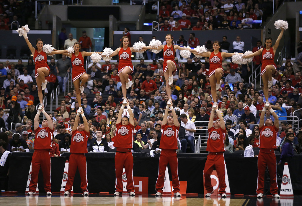 . Arizona\'s cheer team performs during the second half of Arizona\'s West Regional semifinal against Ohio State in the NCAA men\'s college basketball tournament, Thursday, March 28, 2013, in Los Angeles. (AP Photo/Jae C. Hong)