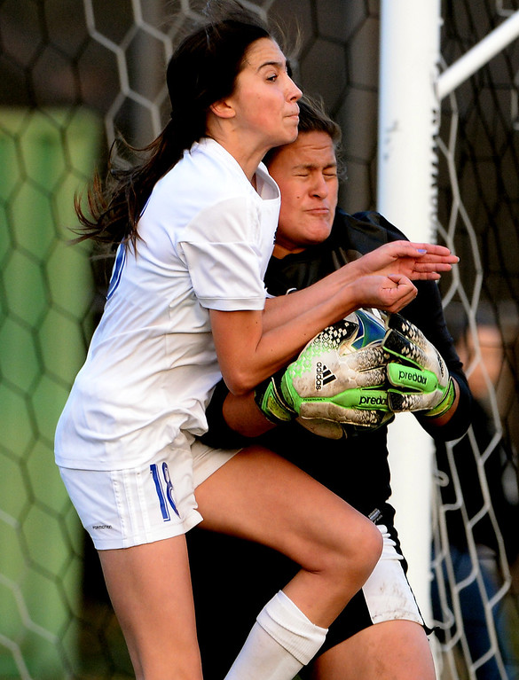 . Bishop Amat\'s Ashley Rushlow (18) goes-up for the ball with Marshall goal keeper Ariel Martinez (1) in the second half of a prep soccer match at Bishop Amat High School in La Puente, Calif., on Thursday, Jan. 9, 2014.Amat won 3-0. (Keith Birmingham Pasadena Star-News)