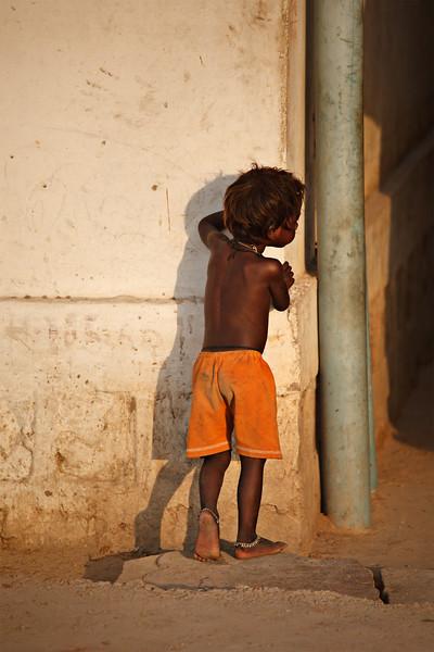 Little boy looking over the corner