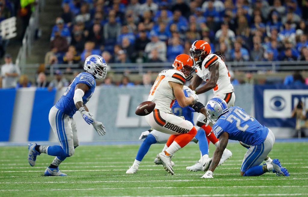 . Cleveland Browns tight end Seth DeValve (87) fumbles the ball near Detroit Lions cornerback Nevin Lawson (24) who recovered the ball and returned it for a 44-yard touchdown during the first half of an NFL football game, Sunday, Nov. 12, 2017, in Detroit. (AP Photo/Rick Osentoski)