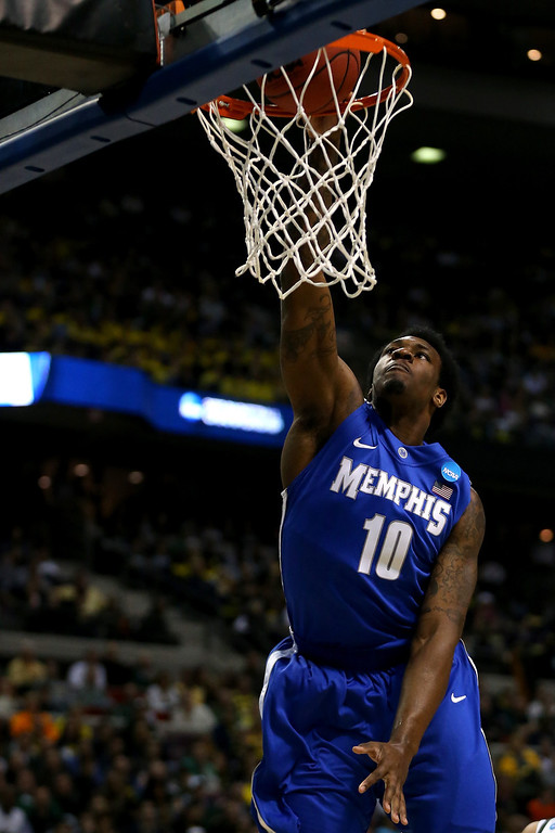 . AUBURN HILLS, MI - MARCH 23:  Tarik Black #10 of the Memphis Tigers dunks in the first half against the Michigan State Spartans during the third round of the 2013 NCAA Men\'s Basketball Tournament at The Palace of Auburn Hills on March 23, 2013 in Auburn Hills, Michigan.  (Photo by Jonathan Daniel/Getty Images)
